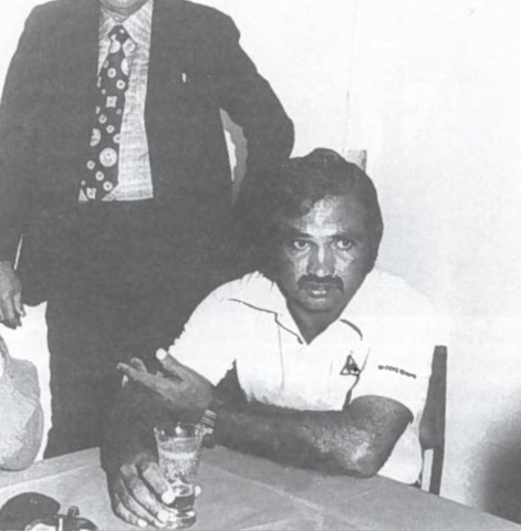 Pakistan cricket captain relaxes with a glass of beer at Karachi's National Stadium after his team defeated the visiting New Zealand side 2-0 (November1976). This was the Pakistan team's first Test series win after three years.