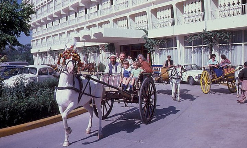 European tourists enjoy a buggy ride outside Peshawar's Hotel Intercontinental (1975).