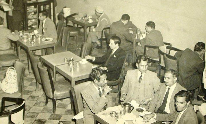 Intellectuals share ideas over cups of tea at a café in Lahore (1962).