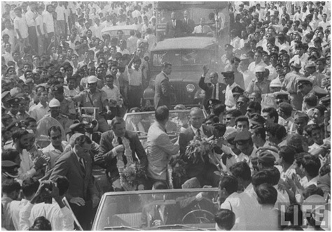 The first men on the moon land in Pakistan. Astronauts Neil Armstrong and Buzz Aldrin (the first men to land on the moon), arrived in Karachi in early 1970s during their tour of South Asia. Here they are seen being greeted by an enthusiastic crowd just outside the Karachi Airport.