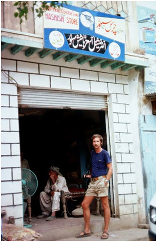 A German tourist outside a 'hashish shop' in the Dir area of NWFP (present-day Khyber Pakhtunkhwa), in 1976.