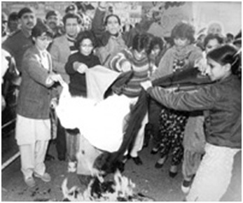Women in Karachi burn their dupattas as a protest against what they termed were Zia's anti-women laws (1981).
