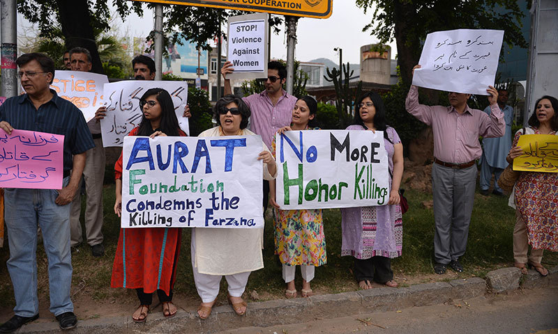 Human rights activists hold placards as they chant slogans during a protest in Islamabad on May 29, 2014 against the killing of pregnant woman Farzana Parveen who was beaten to death with bricks by members of her own family for marrying a man of her own choice in Lahore. — Photo by AFP