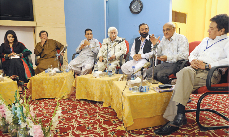 RENOWNED poet Amjad Islam Amjad moderates the discussion on Ghalib's poetry. — Photo by Tanveer Shahzad
