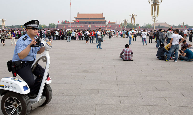 In this May 17, 2014 photo, a policeman patrols on an electric personal transporter on Tiananmen Square in Beijing. — Photo by AP