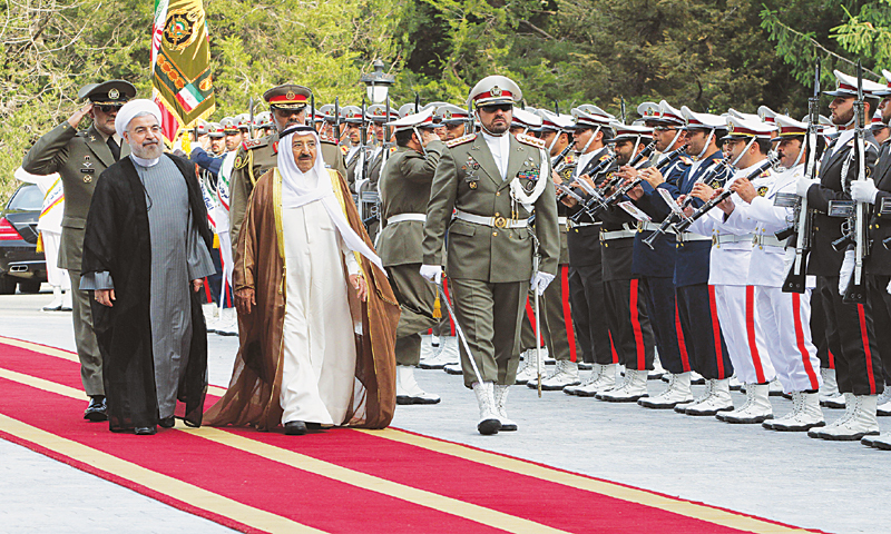 Tehran: Iranian President Hassan Rouhani (left) and Emir of Kuwait, Sheikh Sabah al-Ahmad al-Sabah (second left) review the honour guard at a welcoming ceremony for the Emir upon his arrival here on Sunday.—AFP