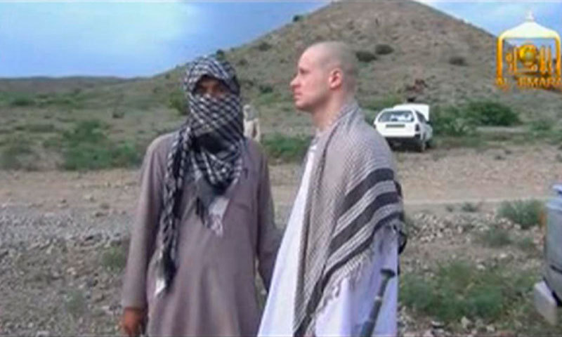 US Army Sergeant Bowe Bergdahl (R) waits before being released at the Afghan border, in this still image from video released June 4, 2014. — File photo