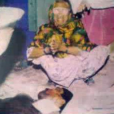 A grandmother of a slain MQM worker wails over his body during the first operation against the party in 1992.