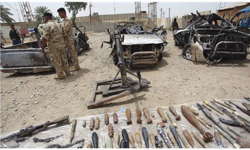 Iraqi security forces display vehicles, weapons and ammunition confiscated from the Sunni militant group