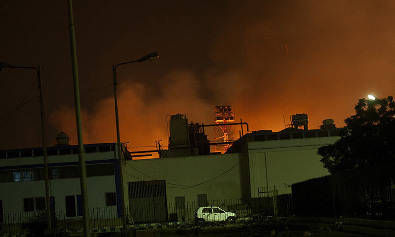 Fire illuminates the sky above Karachi airport terminal where security forces are fighting with attackers. -AP Photo