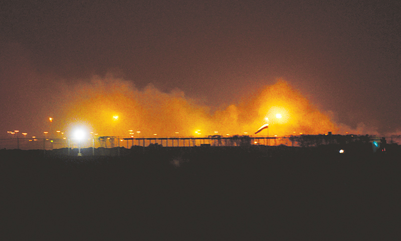 PART of the airport engulfed in flames after the attack on Sunday night.—White Star