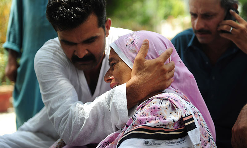 Pakistani relatives mourn missing family members following an assault by militants at Karachi airport terminal in Karachi on June 9, 2014. – AFP Photo
