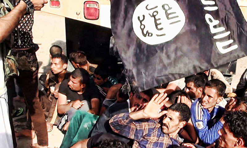 This image posted on a militant website on Saturday, June 14, 2014, which has been verified and is consistent with other AP reporting appears to show militants from the al-Qaida-inspired Islamic State of Iraq and the Levant (ISIL) with captured Iraqi soldiers wearing plain clothes after taking over a base in Tikrit, Iraq. - AP