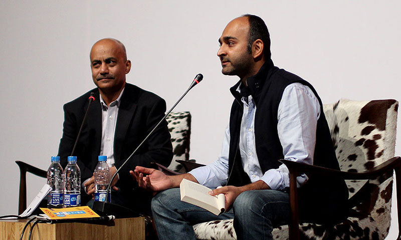 Moshin Hamid (R) reads from his book 'How to Get Filthy Rich in Rising Asia' at the Lahore Literary Festival 2013 . – Photo by Sara Faruqi/Dawn.com
