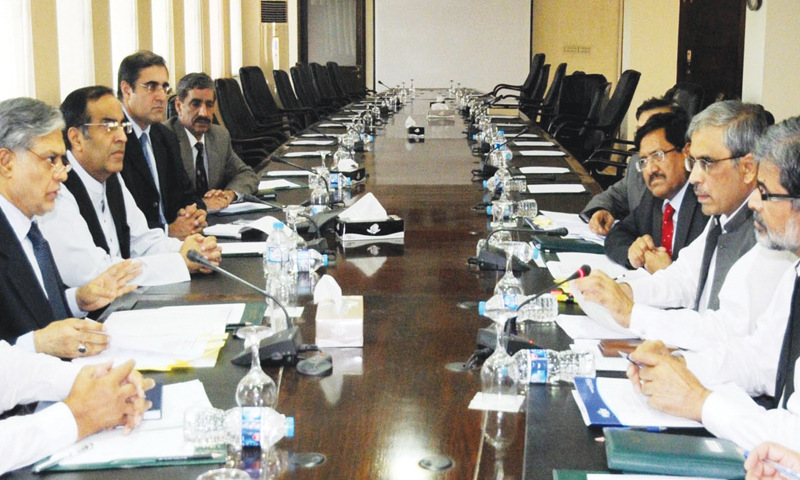 Federal Minister for Finance Ishaq Dar chairing a meeting with FBR officials on the finance bill at the Finance Ministry on Friday. — Photo by INP