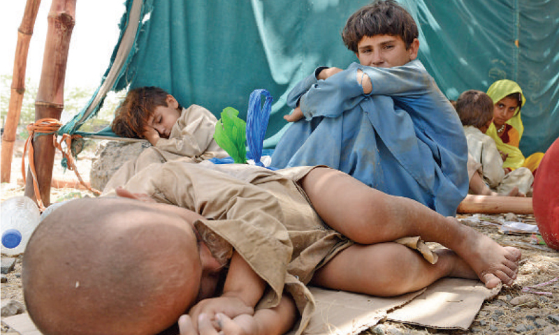 A displaced child sleeps on the ground in Bannu. —White Star