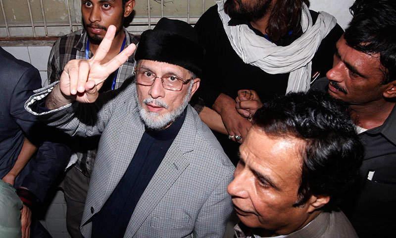 Dr Tahirul Qadri flashes victory sign as he arrives to visit his supporters, who were injured during clashes with the police last week, at a hospital in Lahore June 23, 2014. – Reuters Photo