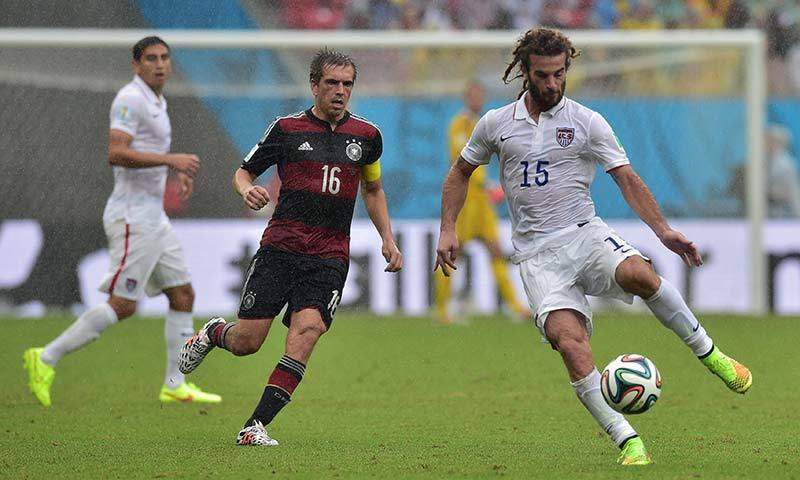 US midfielder Kyle Beckerman (R) and Germany's defender Philipp Lahm (C) vie for the ball during a Group G football match between US and Germany at the Pernambuco Arena in Recife. -AFP Photo