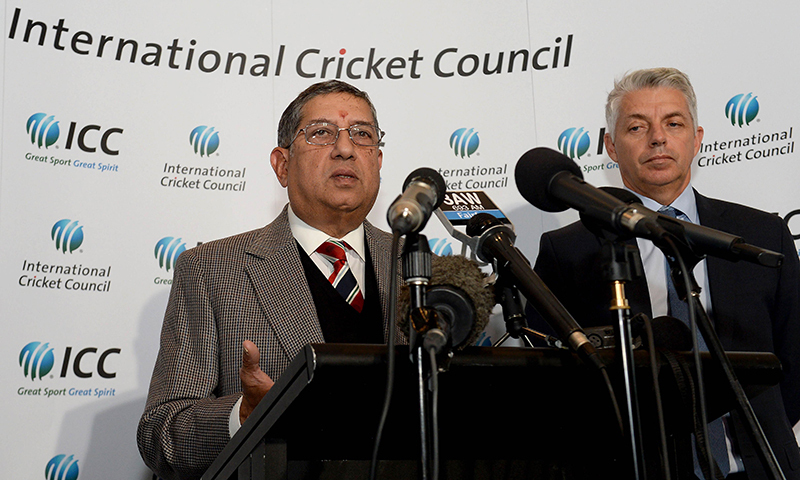 Newly elected ICC chairman N. Srinivasan of India (L) speaks to the media as ICC chief executive David Richardson of South Africa (R) looks on during the ICC Annual Conference. — Photo by AFP