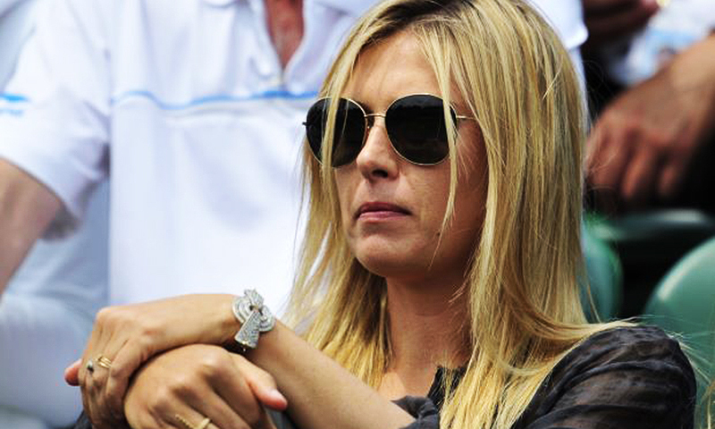 Outraged Indian cricket fans have targeted Sharapova who was among a star-studded crowd at Wimbledon. -Photo by AFP