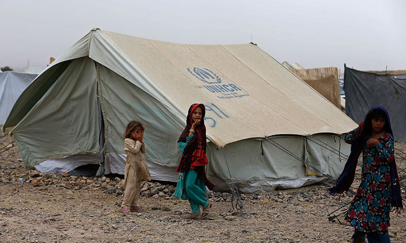 Displaced Pakistani children play outside their tent at a refugee c& in Khost province. - & N Waziristan operation reverses flow of refugees - Pakistan - DAWN.COM