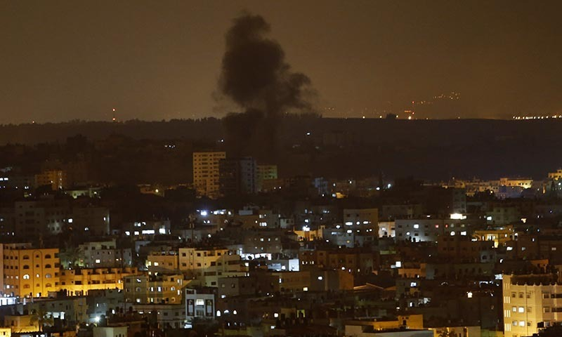 Smoke rises after an Israeli missile strike in Gaza City, in the northern Gaza Strip, Saturday, July 19, 2014. — Photo by AP
