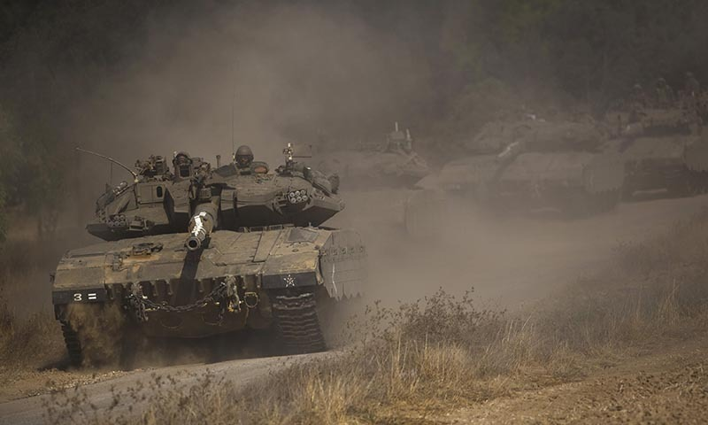 An Israeli convoy manoeuvres outside central Gaza Strip July 19, 2014. — Photo by Reuters