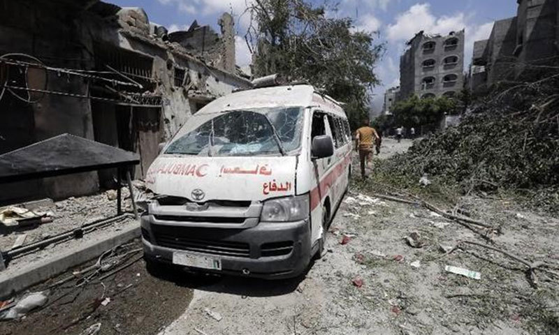 A destroyed ambulance is abandoned on a street following an Israeli military offensive on Gaza's Shejaiya district on July 20, 2014.—AFP photo