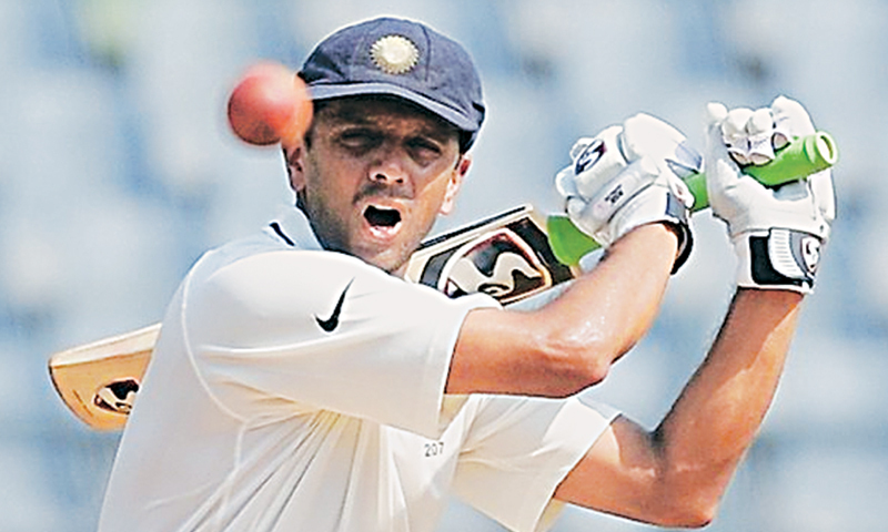 Image result for dravid reading newspaper