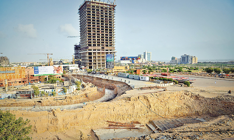 Trenches lie dug up near the under-construction 60-storey Bahria Icon Tower in Clifton as work at the project's traffic improvement plan has been at a halt, causing inconvenience to residents and motorists.—White Star