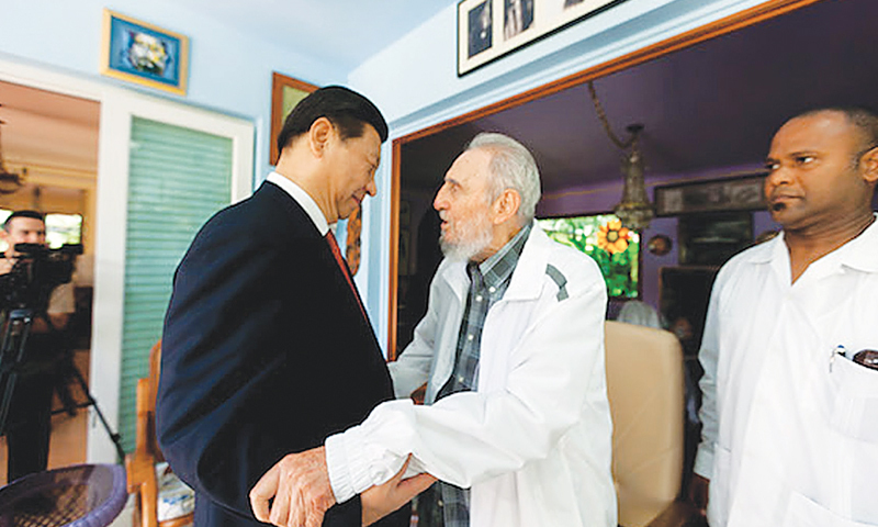 China eyes increased investment in cuba newspaper dawn havana cuban former president fidel castro greeting chinese president xi jinping at his residence here m4hsunfo