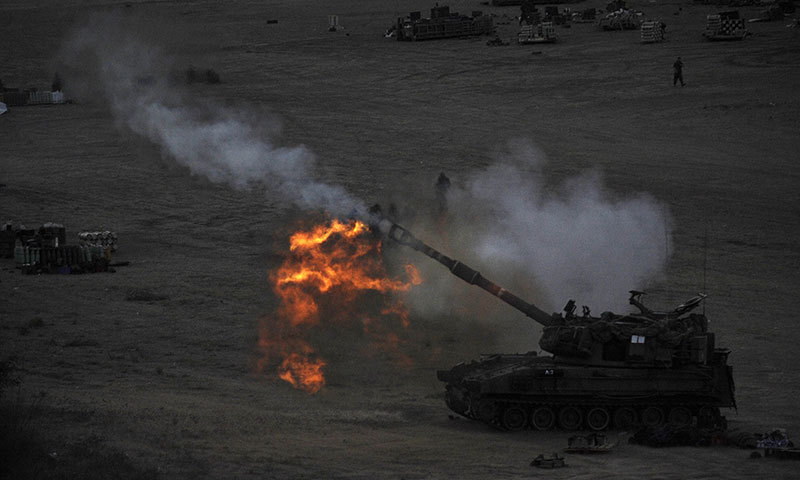 An Israeli tank fires a 155mm shell towards targets in the Gaza Strip from their position near Israel's border with the Palestinian enclave on July 23, 2014.—AFP photo