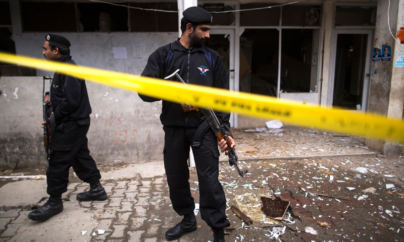 A policeman cordons off the site of a bomb attack at the district court in Islamabad. — Photo by Reuters/File