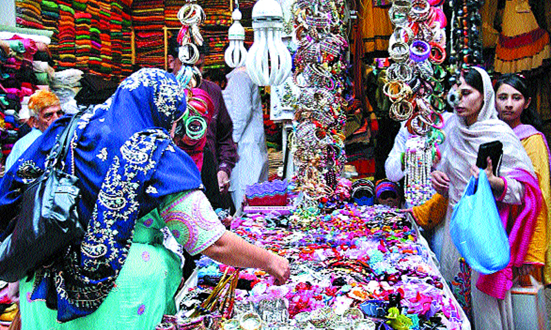 Bazaars buzz with eid shoppers despite outages humidity for Bano bazar anarkali lahore