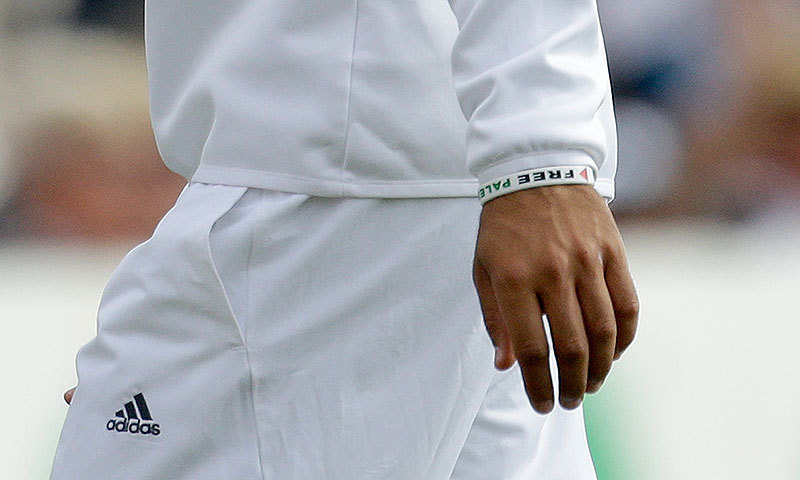 England's Moeen Ali wears a 'Free Palestine' wristband while fielding during the third Test against India. -Photo by AP