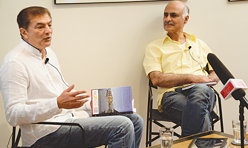 FEROZE Dada (left) discusses his book Children of the Revolution: a True Story that Has to be Told  at T2F on Friday with TCS Express Logistics chairman Khalid Awan. —White Star