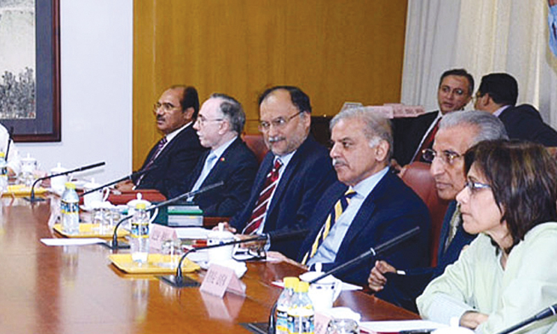 Punjab CM Shahbaz Sharif and Federal Minister for Planning Development and Reform Prof Ahsan Iqbal discussing energy projects with Chinese Vice Administrator of National Energy Administration Zhang Yuqing last month in Beijing.—APP