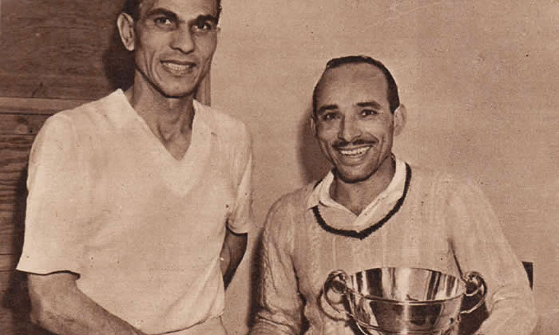 Squash champion Hashim Khan (right) shakes hands with M.A. Karim after winning his first British Open in 1951. -Photo courtesy Squash Films