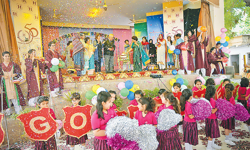 STUDENTS and teachers clap and cheer as Habib Education Trust managing trustee Muslim Habib and school principal Nargis Alvi cut the cake to celebrate 50 years of founding of Habib Girls School.—White Star