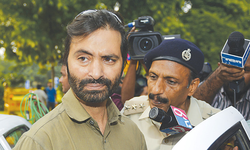 Chairman of the Jammu and Kashmir Liberation Front Yasin Malik arrives at the Pakistan High Commission for a meeting with the high commissioner on Tuesday.—AFP