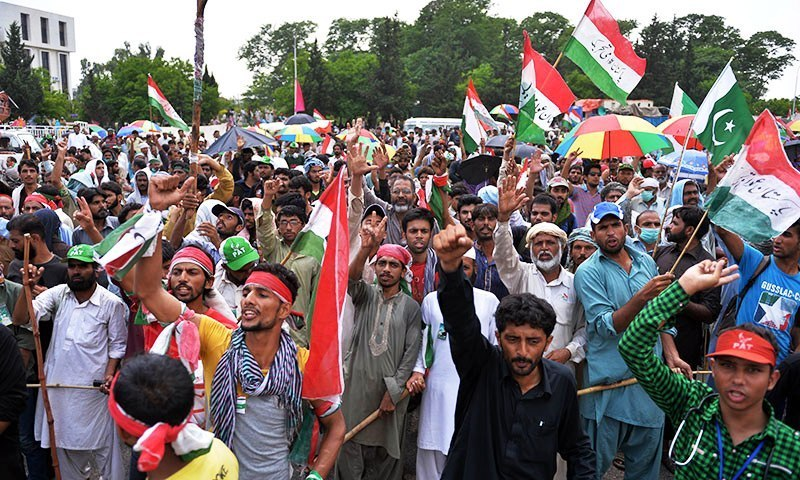 "Supporters of Pakistan Awami Tehreek chief Dr Tahirul Qadri gather in front of the Parliament during the ""Revolution March"" protest in Islamabad on August 20, 2014 — Photo by AFP"