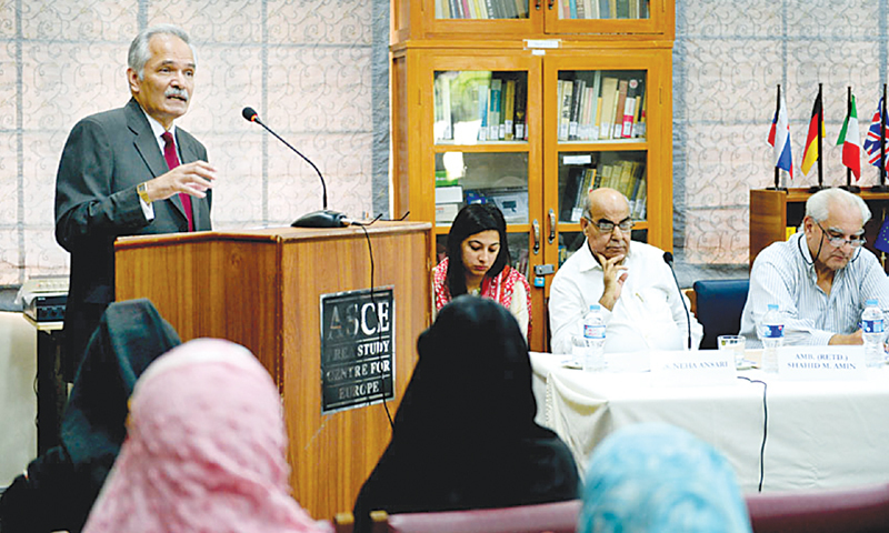 Dr Rifaat Hussain speaks at a seminar titled 'The regional scenario in South Asia after the withdrawal of Nato forces from Afghanistan' organised by the Area Study Centre for Europe, University of Karachi, on Thursday. — Photo by White Star