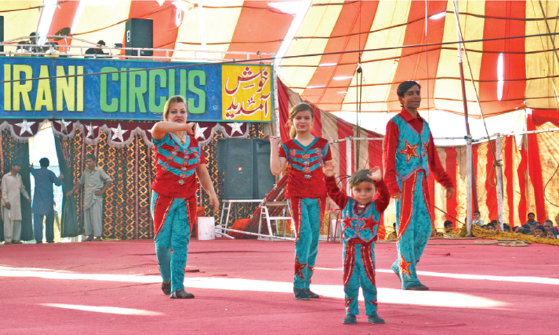 Naveed Malik and his family members display daredevil stunts at the Lucky Irani Circus in Chakwal. — Photos by the writer