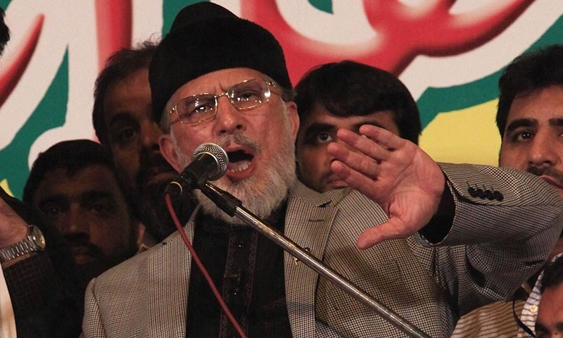 """Tahir ul-Qadri, chief of Pakistan Awami Tehreek (PAT), speaks to his supporters in front of the Parliament House building during a """"Revolution March"""" in Islamabad August 28, 2014.  — Photo by Reuters"""