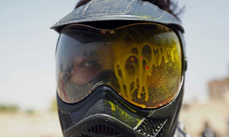 A man shows his goggles after being hit by a paintball bullet in Kabul, Afghanistan. – Photo by AP