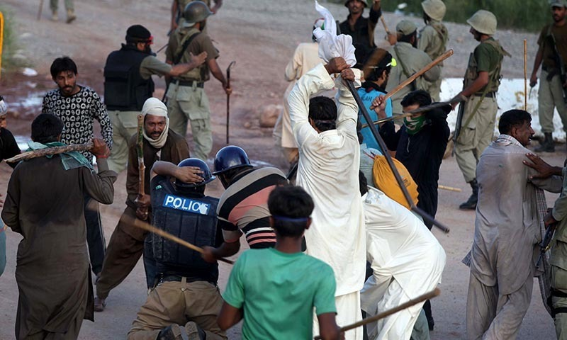 Pakistani protesters beat a police officer during a clash in Islamabad, Pakistan, Monday, Sept. 1, 2014. — Photo by AP