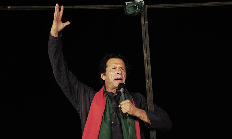 Imran Khan talks to supporters during an anti-government protest near the prime minister