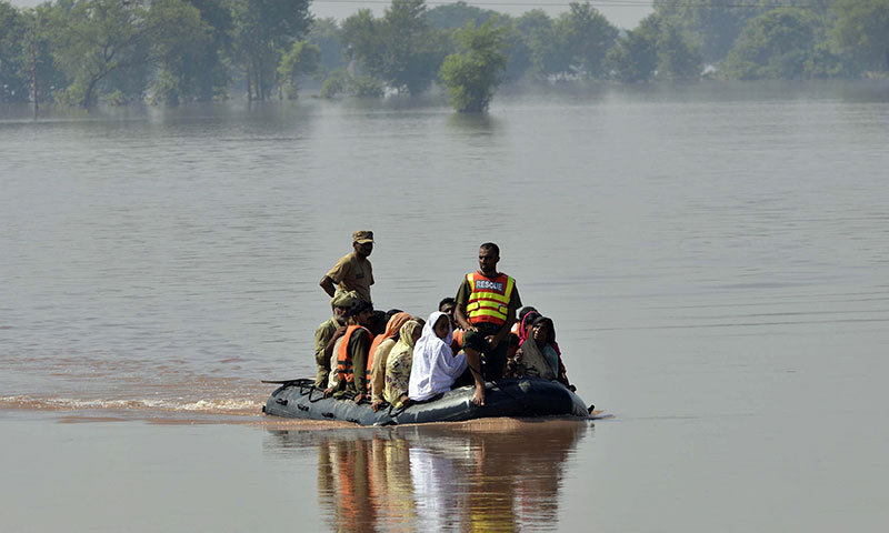 Soldiers use an inflatable boat to rescue flood-affected residents from a village at Jalalpur Bhattian in the Hafizabad district in Punjab province. — Photo by AFP