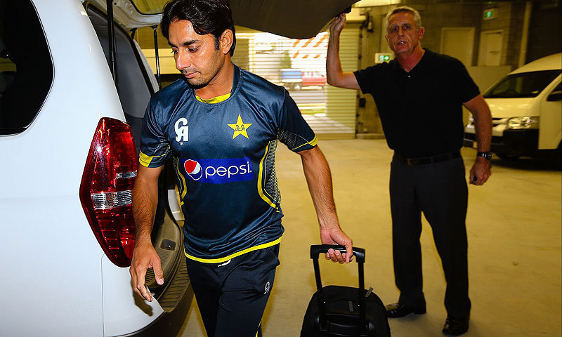 Pakistan off-spinner Saeed Ajmal (L) arrives with a Pakistan official (R) at the Australian National Cricket Centre, Brisbane. — Photo by AFP