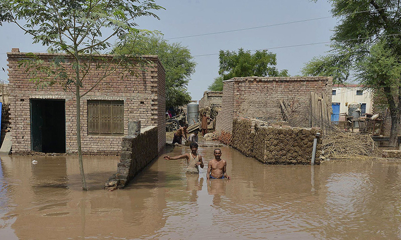 Residents affected by flooding gather outside their houses as they wait for help in Sher Shah, a town in Multan District. -Photo by AFP